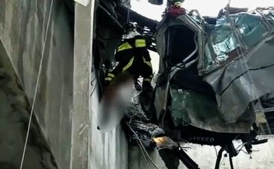 The crushed car was hanging on the wires